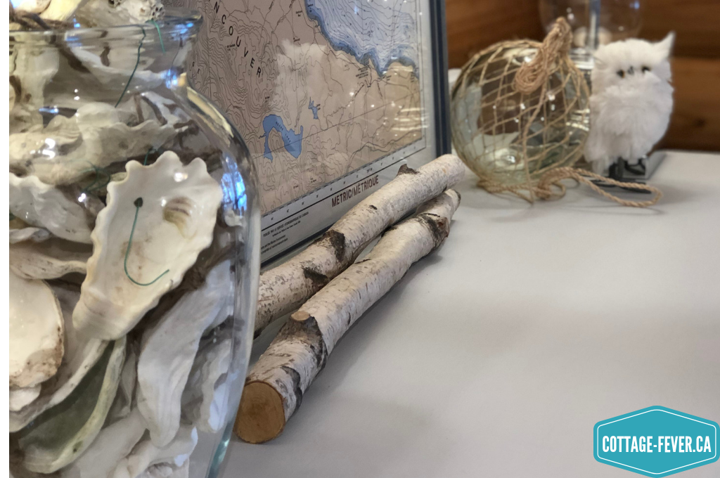 nautical map, birch branches, glass fishing float, white owl, vase, oyster shells