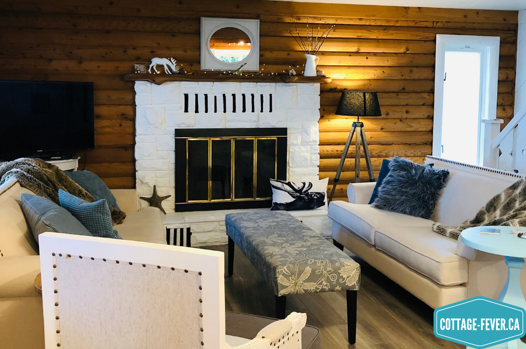 Log home, living room, white painted fireplace, mantel decorations, winter decor, white decor